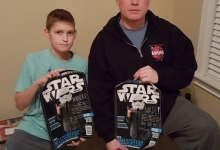Wade and his son Xander with their HelloGreedo posters! *And a very awesome Buzz Aldrin 'Get Your Ass to Mars' hoodie*